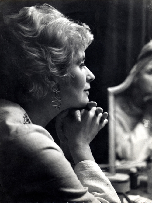 Joan Wyndham looking into mirroe - black and white portrait